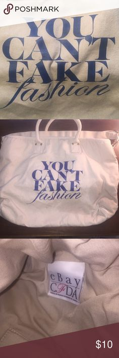 """CFDA & eBay """"You Can't Fake Fashion"""" Tote CFDA and eBay collaboration tote against designer knock offs. Beige cotton canvas with blue screen print. This has been washed so it has a slightly """"tumbled"""" look from wash, but is in excellent condition. 12"""" by 17"""". Adjustable strap allows to be either a shoulder, hand tote, or cross body style. CFDA Bags Totes"""