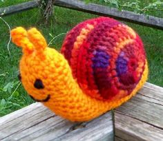 crochet snail ~ Could make more realistic w/camo yarn! Cute for crochet garden scene I'm thinking about making.