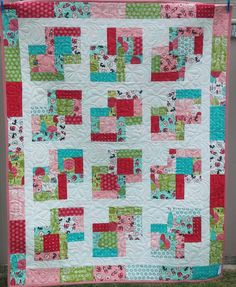Beautiful handmade quilted childs quilt in the fabric collection Lil Red by Stacy Iest Hsu for Moda.  This quilt is just gorgeous with the fabrics showing Little Red Riding Hood and the Big Bad Wolf. I have backed the quilt in one of the all over picture prints with an aqua background which makes this a reversible quilt.  It measures a generous 39 inches by 49 inches or 100 cm by 125 cm making it ideal to use as a crib or cot quilt or as a topper on a single bed.   It has been quilted all…
