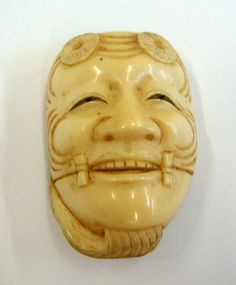 """Smiling Netsuke Japanese Antique Ivory Mask This charming Netsuke mask was hand-crafted of antique ivory and evinces exquisite craftsmanship. Depicting exquisite detail, the mask is of a light-hearted nature. Created in Japan, Netsuke (Japanese: 根付) are miniature sculptures that were originally hand-crafted during the17th-century, during the Edo period.In Japanese, mennetsuke, means """"mask netsuke."""" Meticulously hand-sculpted, [...]  $550.00"""