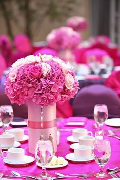 Simple yet beautiful centerpiece.  Use any container...cheap dollar store glass vases, or even cans.  Cover with thick paper (such as scrapbooking), or with material....finish with ribbon or lace.