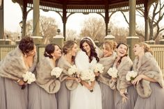 we love this silver/gray bridesmaids dresses and shawls and off white bridal gown - nice color combination