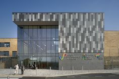 Bolton St Catherine's Academy and Firwood High School. The schools, which opened to students in 2012, provide learning facilities for an all-age academy of 1,160 students and a co-located special school which provides an inclusive 'single learning community' under one roof. Designed by architects Sheppard Robson, the new facility supports the amalgamation of the two schools, and the entire community is designed to be accessible to special education needs (SEN) students. Building Photography, Photography Projects, Image Photography, Civil Engineering Projects, Rainscreen Cladding, Architectural Photographers, Social Housing, Facade Architecture, Skyscraper