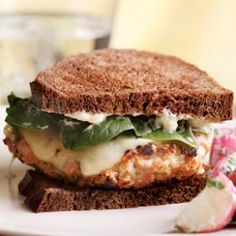 The classic flavors of Chicken Cordon Bleu—ham, Swiss cheese and thyme—inspired this easy chicken burger. We like using regular ground chicken, which is a blend of thigh and drumstick meat, to help keep this burger juicy, but feel free to use 100% ground chicken breast if you'd like a leaner burger. You'll cut 20 calories and 1 gram saturated fat. Serve with roasted broccoli.