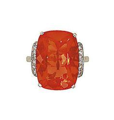 A fire opal and diamond ring   The cushion shaped fire opal to vari-cut circular diamond line side detail and graduated diamonds line shoulders