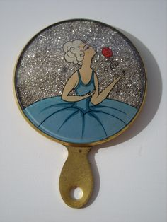 French glitter celluloid miniature mirror.  I would love to find one of these mirrors and make it my own.