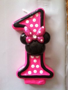 Handpainted Polka Dotted candle with sparkly, rhinestone Minnie Mouse Head embellishment - ANY NUMBER via Etsy