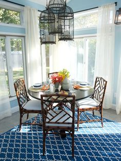 Bamboo chairs and a solid mahogany table create a natural vibe.