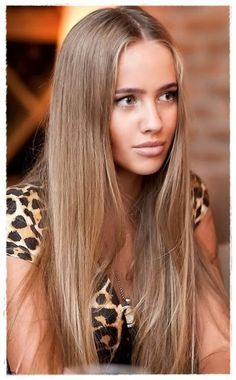 This is a very flattering light brown hair color that borders on ash brown.