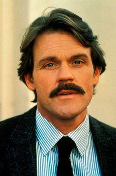 John Beck as Mark Graison.