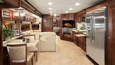 The Tuscany XTE living space is exquisite with hand laid porcelain tile flooring, UltraLeather furniture coverings and solid hardwood cabine. Luxury Rv Living, Luxury Motorhomes, Rv Motorhomes, Studios, Rv Rental, Rv Interior, Remodeled Campers, Interior Design Companies, Minimalist Interior
