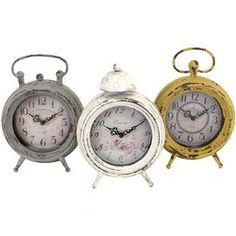 "Add cottage-chic appeal to your mantel, nightstand, or credenza with these beautifully-weathered table clocks.Product: Set of 3 table clocksConstruction Material: MetalColor: Gray, ivory and yellowDimensions: 9"" H x 6.25"" W x 2.25"" D"