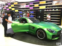 A Chinese man checks out a Mercedes-AMG GT R sports car at a Mercedes-benz showroom in Beijing on August 26, 2017. China has become the…