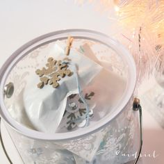 Use a painter's bucket to store inexpensive numbered  wax bags purchased in bulk at Uline adding a soft shabby chic theme to each bag. Insert scripture cards, little tokens of love like chapstick, candy and hand-written notes.  Aedriel: DIY Advent Calendar
