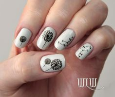 """Lola's Dandelion Mani:  OPI """"My Boyfriend Scales Walls"""", Stamped with Wet 'n Wild """"Black Créme"""", MoYou London Pro 04 image plate."""
