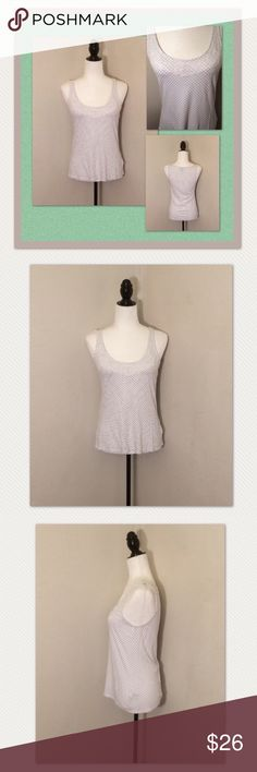 NWOT Elle polka dot lace sleeveless top NWOT Elle black and white polka dot lace sleeveless top size medium. This adorable tank top is very soft to the touch. It features a gorgeous white lace overlay to dress it up! Never been worn, in perfect condition! Elle Tops Tank Tops