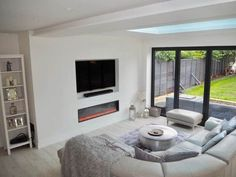 Check out this Scandinavian inspired white modern contemporary open plan kitchen living room with bi folding doors.