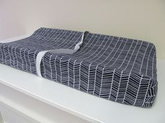 This listing is for one contoured changing pad cover in Herringbone Lake in navy and white (as shown in first photo), or the fabric of your