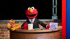 "The most cynical read of ""The Not Too Late Show With Elmo,"" one of the few original series launching HBO Max, is that it's a canny way to capitalize on new streaming service'… Super Hero High, Hbo Go, Looney Tunes Cartoons, T Tv, Dc Legends Of Tomorrow, Tv Reviews, Hbo Series, Programming For Kids, Top Videos"