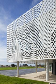 Architecture studio PAD has used solid surface material HI-MACS to create the perforated facade of this headquarters for a boat manufacturer. Cladding Design, Facade Design, Steel Railing, Bridge Design, Wall Finishes, Environmental Graphics, Facade Architecture, Inspiration Wall, Arquitetura