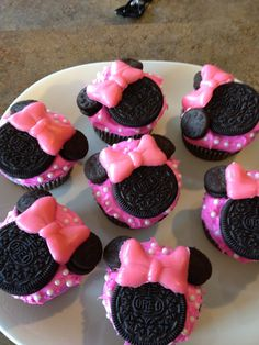 """Sutton requested Minnie Mouse cupcakes for her 4th Birthday. I used regular sized and mini oreo cookies and ordered a bow mold off Etsy. I used Airheads candy in the bow mold, it was super easy! The white """"polka dots"""" are the white pearls (edible) you can find at Walmart, Target, etc in the cake decorating aisle."""