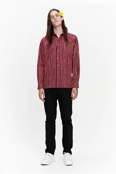 The Jokapoika is a unisex shirt featuring the Piccolo pattern. It is a loose fit shirt with a straight cut to the hip hemline with little side slits and a stitched-on chest pocket. Metal buttons secure the front closure and cuffs. Marimekko, Long Toes, Metal Buttons, Straight Cut, My Size, Loose Fit, Printed Shirts, Hemline, Cuffs