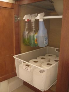 Bathroom under the sink organization - tension rod for cleaners! Guest bathroom cleaning supplies