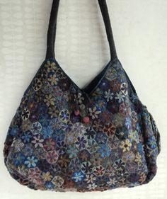 linda bolsa de mano hecha con tus propias manos......patron combinado con tela y crochet