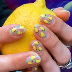 Lovely Summer Nail Art Ideas #fruitsdesign #nailsart #yellownails ❤️Sunny Shades of Yellow Nails You Can Try ❤️ See more: https://naildesignsjournal.com/yellow-nails-shades/ #naildesignsjournal #nails #nailart #naildesigns