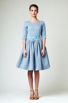 Silhouette: fitted bodice with boat neck at the front and low back, three quarter sleeves and full, gently pleated midi skirt.