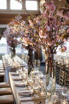 We love the grand cherry blossom arrangements for these long reception tables.