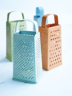A grate idea ~ Twinkling lights bring a magical ambience to outdoor soirées. Make sure your lights don't blow out under these clever candle lanterns. Collect inexpensive or old metal box graters from thrift shops and spray paint them with a summery palette. Pop your candles underneath and watch the gentle flicker of the candlelight twinkle through the holes in the grater.