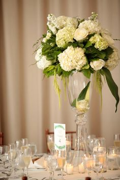 For a garden wedding we planned at The New York Botanical Gardens, this all white and green tall centerpiece was elegant and classic on every table.