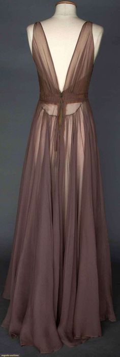 VALENTINA Mauve Evening Gown, 1930s. Unlabeled & bought at Valentina Schlee's personal estate sale #6951 Christie's East, 1990: silk chiffon goddess gown, deep V-neckline F & B, sleeveless, above high waistline bodice's gathers held in place by 3 narrow bands, silk bodice lining, hand finished details. (hva)