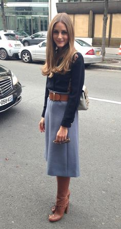 Blue sweater and dark skirt with leather belt and boots