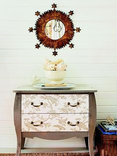 Classy Update:: Transform a dresser with paint and wallpaper. Chic taupe paint and toile wallpaper highlight this dresser's traditional lines. Play with the position of the wallpaper until you're happy with the design, and then cut the paper to fit the drawer fronts. After painting the dresser, apply the wallpaper; protect it and the painted surfaces with an acrylic sealer