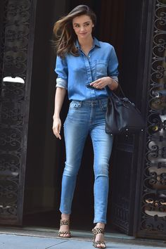 Street Style queen Miranda Kerr in double denim - jeans and shirt with leopard print sandals