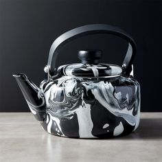 Shop Brew Enamel Teapot. Marbleized black and white enamel gives classic teapot a modern twist. Carbon steel is safe for stovetop use, while painted wood handle makes for easy pouring. CB2 exclusive.