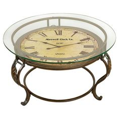 Glass-topped coffee table with a working clock face and curved legs.Product: Coffee tableConstruction Material: Metal ...
