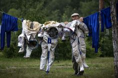 Dare we ask what a laundry day looks like as seen through the eyes of a cosmonaut? .................................................... Image by Alexander Zemlianichenko/AP/SIPA: An employee of Russian Space Training Center hangs out to dry space suits of Russian cosmonaut Anatoly Ivanishin, NASA flight engineer Kathleen Rubins, and Japanese space agency flight engineer Takuya Onishi after a training session simulating a capsule landing on water on July 2, 2014 near Noginsk, Russia.