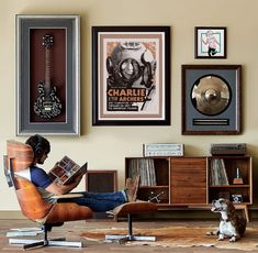 Custom Frame at JOANN and surround yourself with what you love. A combination of shadow boxes, framed concert tickets, posters and memorabilia assemble a gallery wall of your favorite things.