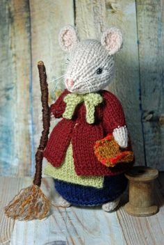 This adorable little harvest mouse is getting ready to prepare her house for the Fall and Winter Season. She is dressed in a cozy blue skirt with