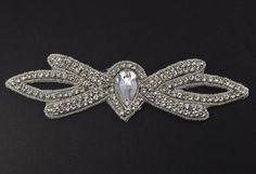 SALE, SALE 45% off Was $ 9 Now $5 only for the month of November.   This listing is for:    Quantity: 1 pc rhinestone applique Size: 7.5 inches x 2