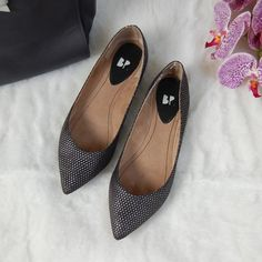 BP Studded Pointy Toe Flats Black and silver pointed toe flats. Fabric upper, leather sole. Front soles have been reinforced with a rubber sole. Heels show usage. No box. Runs small (in between 6 and 6.5 in my opinion). BP Shoes Flats & Loafers
