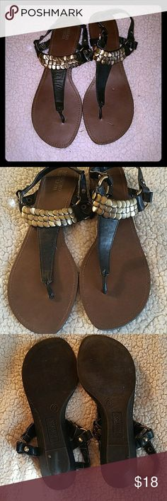 Mossimo black embellished mini wedge sandals 9 Mossimo black mini wedge embellished sandals. Size 9. Only worn a couple times and still in awesome condition. Gold layered coins embellishing the ankle strap. Very cute. Man-made materials. Mossimo Supply Co. Shoes Sandals