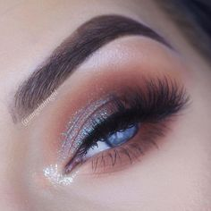 iridescent shimmery glitter over orange brows, lashes