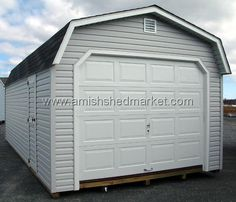 "3.jpg -  DOOR CLOSED - 12' x 24' Dutch Garage  Gray Asphalt Shingles Gray Vinyl Siding White Trim  30"" Vinyl Clad Single Door 9' x 7' Standard Garage Door Optional End Vents"