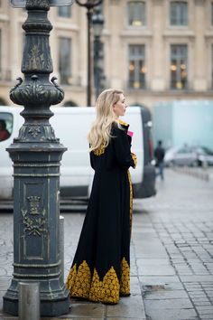 What a coat with all that gold embroidery. Paris