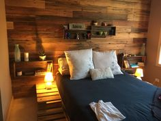 Reclaimed paling fence wall and pallet bed