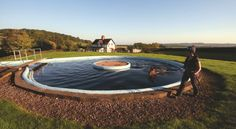 Racehorse having a training session in a circular equine swimming pool
